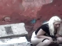 Blonde girl pissing in the back alley