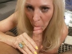 Sexy Deborah sucks a veiny pecker in blonde milf video
