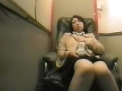 Asian woman watching porn and masturbating in video room