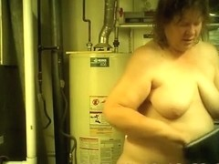 Mature chubby woman drying her body