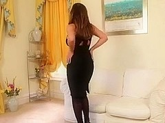 Busty Stacey Poole Teases In Black Dress