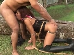 Outdoor domination act for a butty black shemale tart