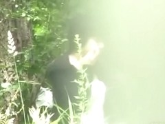 Asian babe gets boob sharking while pissing in the woods.