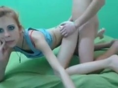 Flat little webcam girl receives a load on her face