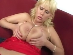 Voluptuous blonde relinquishes her hungry snatch to a hung black stud