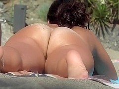 Hottie with lovely ass by the beach