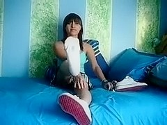 Here is the alluring young dark brown hair gal to tease you with her feet