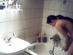 Cute brunette girl spied in bathroom