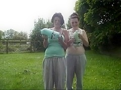 Two hot babes with big belly's do the milk challenge...