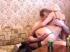 Drunk blonde in lingerie Elvira has a horny guy hammering her snatch