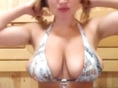 Busty babe shows off her amazing tits 2