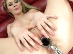 Voluptuous blonde has a fucking machine driving her twat to pleasure