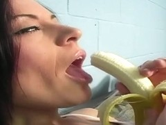 Brunette With Banana and Priest