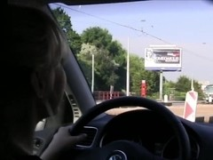 Lesbians playing in the car while driving girlfriend licking