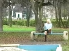 Spying Girl On Phone on Public Garden