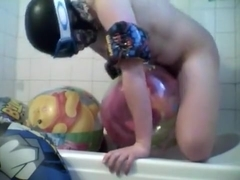 Fun in beach ball bath