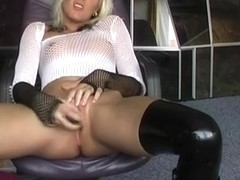 German blonde masturbates hard in boots