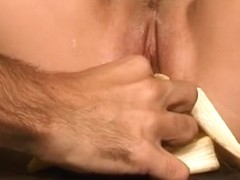 Cathy Anne has a banana fetish putting one in her mouth and cunt